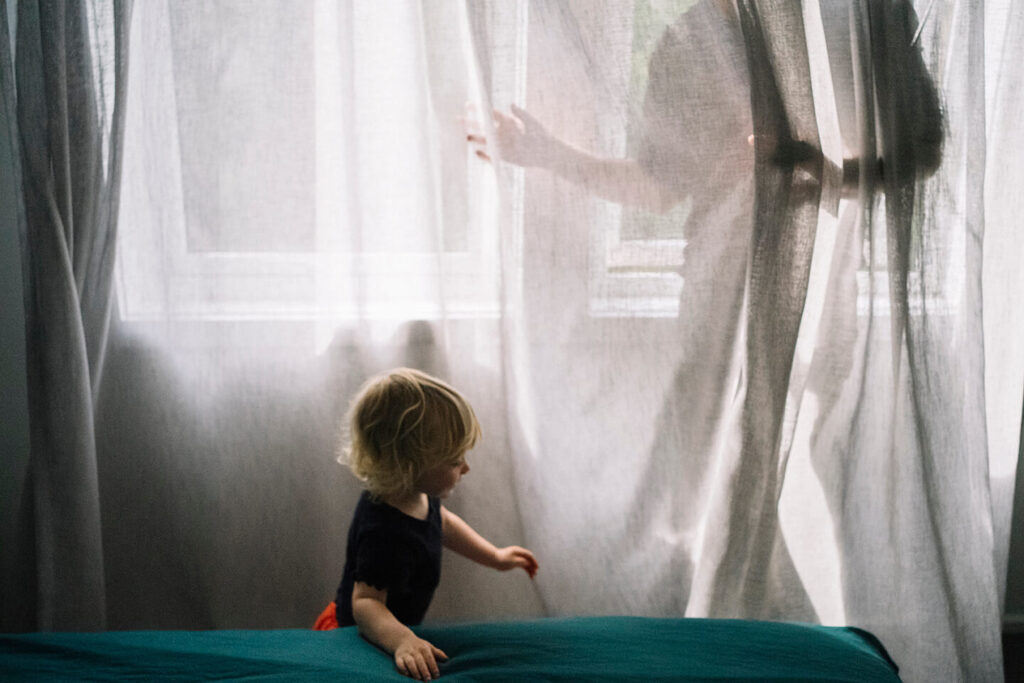 Father-chases-daughter-behind-transparent-curtains